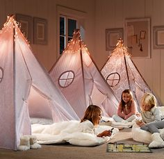 slumber party in tents ~ super cute BUT this is from the restoration hardware catalogue as an ad for the sparkly lights on top of the tents so probably WAY out of my realm of actually recreating ...