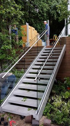 stainless steel glass rail fabricated and installed by Custom iron Craft out of Wilmington/Tewksbury Ma. Handicap Ramps, Balcony Railing, Fence Gate, Garden Bridge, Iron, Outdoor Structures, Stainless Steel, Craft, Glass
