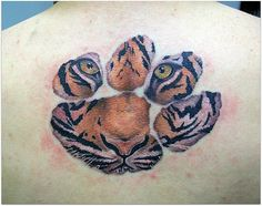 Tiger tattoo. Jessie at Hole in the Wall, Conway, SC does beautiful tiger representations.