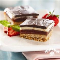 Smooth chocolate, sweet strawberries and a crunchy crust make these Triple Chocolate Strawberry Cookie Bars from Eagle Brand® a Spring baking favorite!