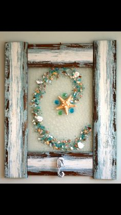 White frame sand, N in seashells, maybe piece of seaglass at each corner?Beautiful.