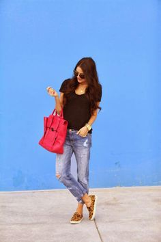 Black haf sleeveless blouse with dark red pink cute leather hand bag and sky blue casual denim stylish jeans and leopard cute pumps