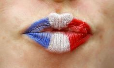 The lips of a French supporter are painted in the colors of the national flag, prior to the Euro 2016 Group A soccer match between France and Romania, at the Stade de France, in Saint-Denis, north of Paris, Friday, June 10, 2016. (AP Photo/Frank Augstein)/ALT126/333849430141/1606102056