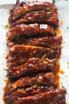 The most crazy-tender, fall-off-the-bone pork ribs you've ever tasted; made in your slow cooker! These SLOW COOKER RIBS couldn't be easier to make, and the end result will knock your socks off! Spare Ribs Slow Cooker, Slow Cooker Ribs Recipe, Slow Cooker Barbecue Ribs, Bbq Pork Ribs, Cooker Recipes, Pork Back Ribs, Slow Cooked Ribs, Crockpot Pork Spare Ribs, Crockpot Pork Ribs Boneless