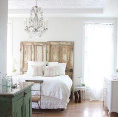 Repurposing old doors as bed headboards
