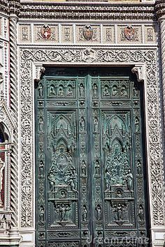 Bronze Door Symbols Duomo Cathedral Florence Italy by William Perry, via Dreamstime