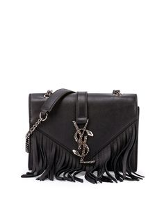 """Saint Laurent calfskin crossbody bag. Chain crossbody strap; 21.3"""" drop. Peaked flap top with fringe trim. Chain serpent YSL logo strap on flap. 4.7""""H x 6.7""""W x 2.4""""D. """"Monogram"""" is made in Italy."""