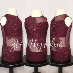 Rich burgundy base leotard with mesh torso. Beautifully coordinated beaded and sequined appliqués going cross-body from right shoulder to left hip. More sparkle added with Swarovski Crystals.