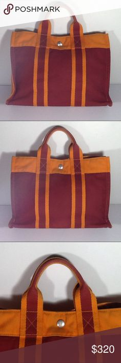 Auth Hermes Fourre Tout Red Orange Canvas PM Bag. Very good condition. The bag was made in France with its dimension 12, 8.5 and 3. Hermes Bags Satchels
