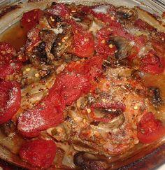 Pork Chops with Seasoned Tomatoes