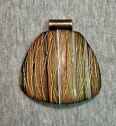 Polymer clay pendant focal bead textured stripes gold bronze copper silver   Flickr - Photo Sharing!