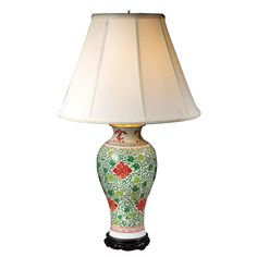 Guan Yin Lamp Guan Yin is a goddess in Chinese folk belief,revered for her unconditional love, compassion and mercy. The design on the neck of this lamp is an interpretation of her hands. Handmade eggshell piped empire shade is washable. 16 diameter at base of shade x 27 1/4h.