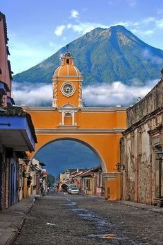 Antigua, Guatemala.  Black beans, Chicken buses, and three active volcanoes rule the town.  But mostly the black beans.  In Antigua, they are sublime.