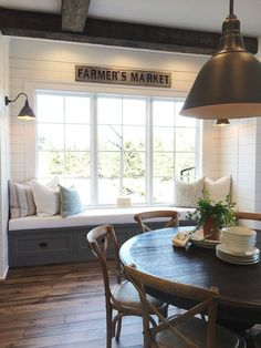Farmhouse style dining room with shiplap and window bench
