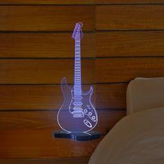 A Fábrica da Moldura apresenta a linha de luminosos nas formas dos mais famosos instrumentos musicais de cordas do mundo.  Composição: Acrílico fluorescente e preto, iluminação em LED e cabo com saída USB.  Dimensão: 13x12x30cm   Cuidados: Para limpeza utilize apenas flanela macia com água, sabão ou detergente neutro. Nunca use solventes, esponjas ou abrasivos.
