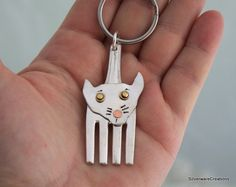 Hey, I found this really awesome Etsy listing at https://www.etsy.com/listing/233646756/silverware-cat-key-chain-silverware