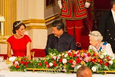 Chinese President Xi Jinping smiles at the Duchess of Cambridge as they sit at the top table with Queen Elizabeth at a state banquet at Buckingham Palace this evening