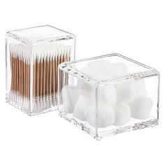 The clean lines of our Acrylic Square Canisters with Lids look great in any décor.  They're sized to fit cotton balls and swabs, and also work well to corral jewelry and cosmetics.  The clarity of the durable acrylic allows for quick identification of the contents.