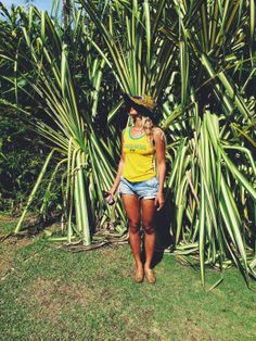 Beyoncé enjoying the sun and red stripe beer while in Jamaica