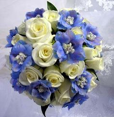 I'd tuck the blue in a little bit more and integrate some greens up in the bouquet