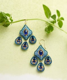 Crystal, quartz and Japanese Miyuki beads waltz in shimmering shades of blue in handcrafted drop earrings.