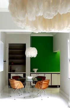 feather chandelier :: green wall