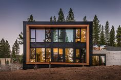 FOR SALE: Martis Camp, Truckee. n the forest, you come across an assortment of inspiring sights, all compliments of Mother Nature. Here at the edge of the forest and end of a cul de sac, however, you encounter a spectacle that's anything but raw — a 5,923-square-foot mountain modern home that exudes class and refinement. The exterior with its knot-free, vertical grain cedar reads like a modern museum, as does the oversized, glass front door.