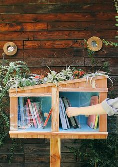 An adorable Little Free Library with its own tiny garden!