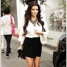 Cream/black long sleeved romper as seen on KimK!!! Cream and black romper with side tie belt. Sophia romper as seen on Kim Kardashian!!! Only wore once. PRICE IS FIRM. Blaque label Other
