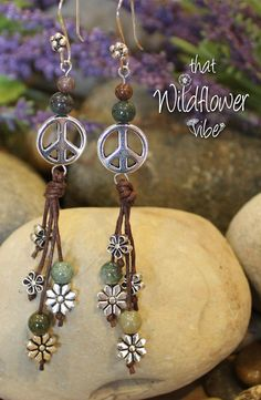 Silver Plated Metal Peace Sign (13mm), Silver Plated Flowers, 4mm and 6mm Round Fancy Jasper Beads and Brown Waxed Cotton Cord are what make