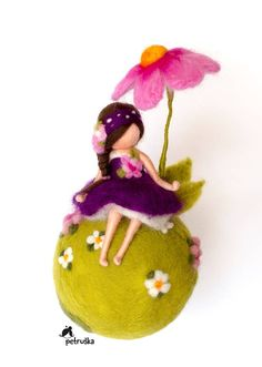 spring fairy sitting under the flower mobile home decor