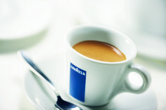 Espresso: Italy's favorite coffee. Espresso is brewed by forcing a small amount of boiling water under pressure through finely ground coffee beans, which produces a foam with a creamy consistency on top called 'crema'.