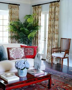 Designing around a large red and blue antique oriental rug in your living room...