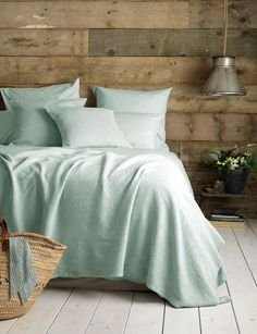 Our Washed Cotton Percale in duck egg in the cosiest little cabin bedroom.