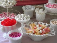 Candy table using milk glass containers really makes the colors pop!