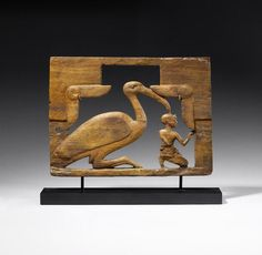 An Egyptian wooden furniture attachment. Possibly Ptolemaic Period or later.