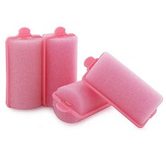 "Pink foam hair rollers for those""Nelly Olson"" curls."