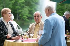 2013 Reunion event.  The fountain in the pond in the background is a serene touch.  Flowers were kept simple, with corresponding, spring linens.  Centerpieces on tables were gerbera daisies in bubble bowls, and larger long and low arrangements adorned food tables. #donorlove #events