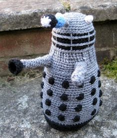 These are instructions to make a classic 1970s grey and black Dalek or a bronze and gold new series Dalek. They are quite complicated, using different stitches and some difficult colour changes, so this pattern is recommended for fairly experienced amigurumi crocheters.