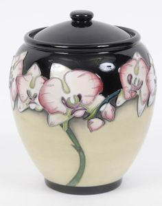 A Moorcroft pottery jar and cover, decorated Orchids, : Lot 77