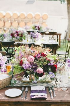Purple centerpiece: http://www.stylemepretty.com/2014/10/29/vintage-chic-winery-wedding-with-pops-of-purple/ | Photography: Onelove - http://www.onelove-photo.com/
