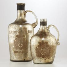 One of my favorite discoveries at WorldMarket.com: Mercury Glass Handled Bottles