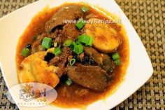 #Filipino chicken liver steak [chicken liver, garlic (minced), soy sauce, Calamansi (calamodin = fruit like kumquat/oange), onions (ringed), chopped ginger, ground pepper, hardboiled eggs, green onion]. Read more: http://www.pinoyrecipe.net