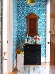 A dark vintage dresser acts as the perfect grab-and-go storage for keys and accessories. More flea market home accents: http://www.bhg.com/decorating/decorating-style/flea-market/flea-market-chic-home-accents/?socsrc=bhgpin070613bluewallpaper=19