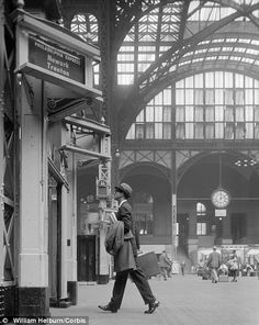 Man in the early 1960s is about to board a Philadelphia Express train.