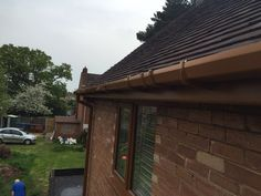 Before and after photos of a #golden oak #fascia #soffit and #guttering and #golden oak #windows installed in #Stafford.