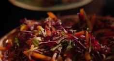 "Nigella Lawson served up a tasty sweet and sour rainbow coleslaw for the festive season on Simply Nigella Christmas Special. Nigella says: ""Here is an exercise in chopping meditation for you! There is much to slice, but you end up with a bright tangle of slaw that feeds a crowd and has enough zing in it to bring a table of cold cuts to life."" The ingredients are: 1 red cabbage (approx. 800g), halved, 4 fat or 6 skinny spring onions, trimmed, 2 red peppers, membranes and seeds removed, 1…"