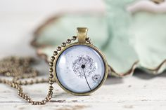Inspiring dandelions on found on this uplifting pendant necklace. https://www.etsy.com/listing/592977461/blue-dandelion-pendant-necklace-gifts