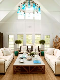 Turquoise chandelier, exposed beams, topiaries, love the table.