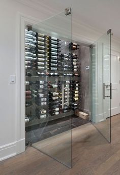 Wine Cellar - Design photos, ideas and inspiration. Amazing gallery of interior design and decorating ideas of Wine Cellar in dining rooms, kitchens, basements by elite interior designers - Page 3 Glass Wine Cellar, Home Wine Cellars, Wine Cellar Design, Wine Cellar Modern, Cave A Vin Design, Best Wine Coolers, Appartement Design, Wine Display, Wine Cabinets